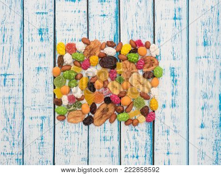 Peanuts, raisins, dried banana, dates, kiwi, mango-candied fruits and dried fruits on the table
