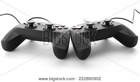 Video game controllers on white background
