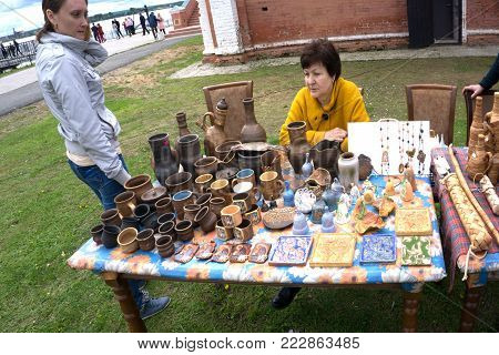 Russia Usolye July 1, 2017 : Pottery market in the village center of pottery production. A variety of pottery: bowls, vases, jars on the market