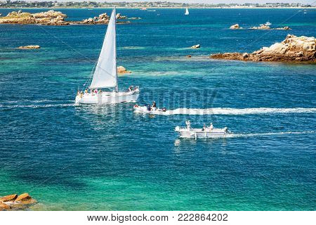 travel to France - above view of yacht and boats near coast of Ile-de-Brehat island in Cotes-d'Armor department of Brittany in summer sunny day
