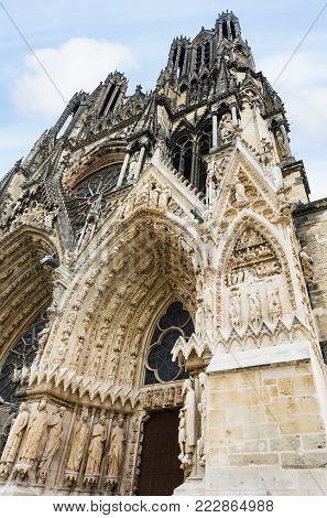 Travel to France - outdoor portal of Reims Cathedral (Notre-Dame de Reims) in summer evening