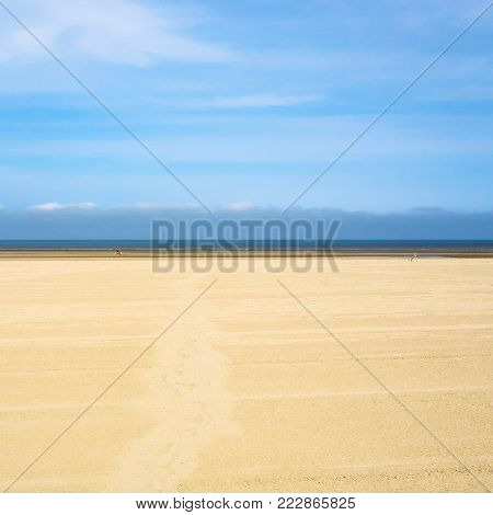 travel to France - blue sky over yellow sand beach of Le Touquet (Le Touquet-Paris-Plage) on coast of English Channel