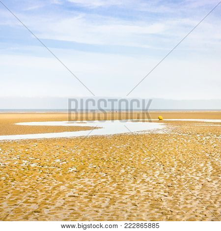 travel to France - blue sky over sand beach of Le Touquet after ebb tide (Le Touquet-Paris-Plage) on coast of English Channel