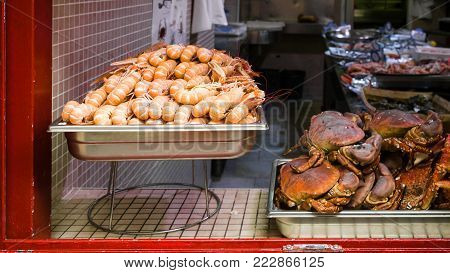 travel to France - local fresh seafood ( langoustines and crabs) in outdoor window of fish shop in Treguier town in the Cotes-d'Armor department of Brittany in summer