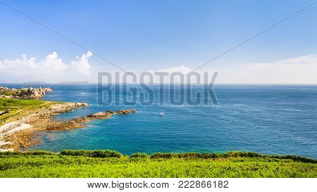 travel to France - view of coastline of English Channel from Saint-Guirec area of Perros-Guirec commune on Pink Granite Coast of Cotes-d'Armor department in the north of Brittany in summer morning