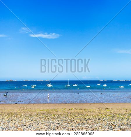 travel to France - beach Plage de la Baie de Launay on bay Anse de Launay of English Channel in Paimpol region of Cotes-d'Armor department of Brittany in sunny summer day