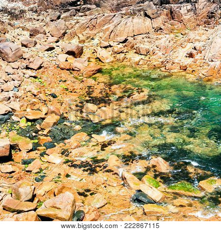 travel to France - pink granite beach of Ile-de-Brehat island in Cotes-d'Armor department of Brittany in summer sunny day