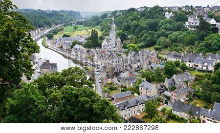 travel to France - view of Dinan town and Rance river from belvedere at Promenade de la Duchesse Anne of the Jardin Anglais (English garden) in rain