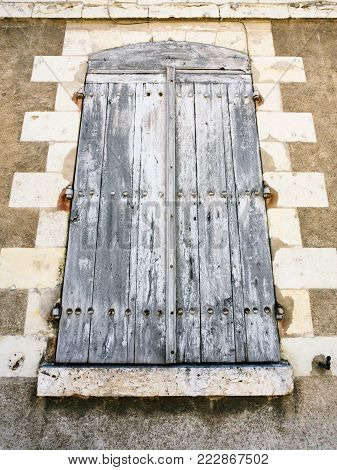 travel to France - windows closed by wooden shutters in old medieval house in Amboise town in Val de Loire region