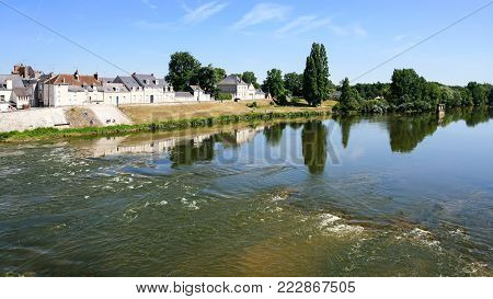Travel to France - flow of water in Loire River near island Ile d'Or of Amboise town in Val de Loire region in sunny summer day