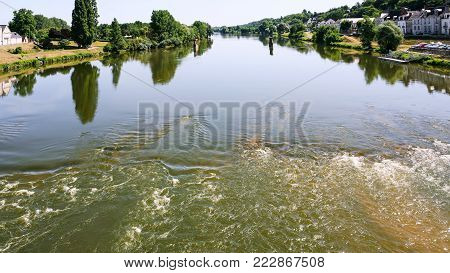 Travel to France - surface of Loire River in Amboise town in Val de Loire region in sunny summer day