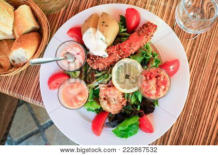 travel to France - top view of plate with big salad with fish in outdoor cafe in Amboise town in Val de Loire region