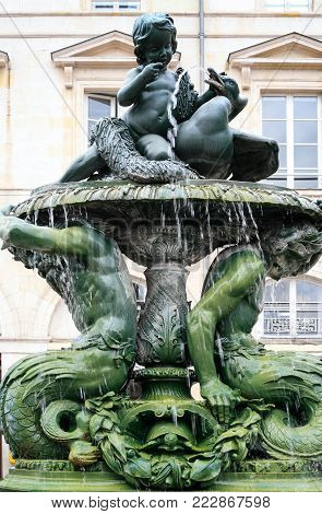 travel to France - old outdoor fountain on square Place Sainte-Croix near Catheral in Orleans city