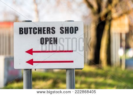 Local Family Business Butchers Shop Open directional sign post.