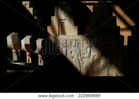 Persepolis is the capital of the ancient Achaemenid kingdom. Sight of Iran. Ancient Persia. Bas-relief carved on the walls of old buildings against the black background.