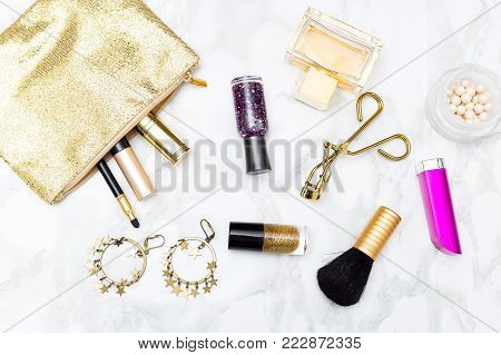 Makeup and accessories on the table. Styled image flat lay