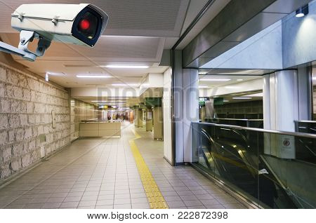 CCTV, security camera system operating with blurred view of subway train station, surveillance security, network connection and safety technology concept