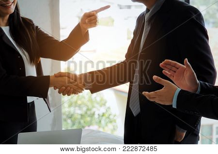 group of business people handshake and clapping hand after finishing up a business meeting in office, success, meeting, partner, teamwork, community, connection concept, vintage tone, selective focus