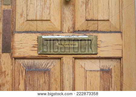 front view detail of residential wooden door with no junk mail inscription on it