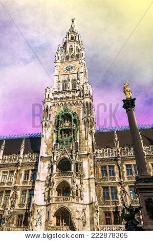 View of Rathaus Glockenspiel in the Marienplatz of Munich at sunset, Germany, Europe
