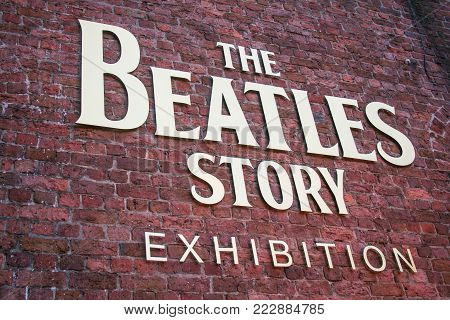 LIVERPOOL, ENGLAND - APRIL 20, 2012 : Sign of The Beatles Story at Albert Dock, Liverpool United Kingdom. The famous museum and exhibition about the music band The Beatles.