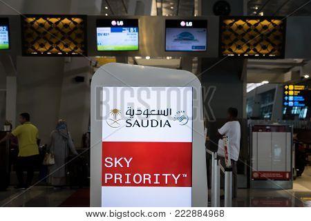 Jakarta, Indonesia - November, 2017: Saudia, Saudi Arabian Airlines, check-in counter at Jakarta (Soekarno-Hatta) International Airport. Saudia is the national carrier airline of Saudi Arabia.