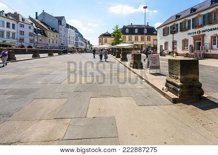 TRIER, GERMANY - JUNE 28, 2010: people on Porta--Platz near ancient roman monument Porta  (Black Gate) in Trier city. The town was founded by the Celts in the late 4th century BC as Treuorum