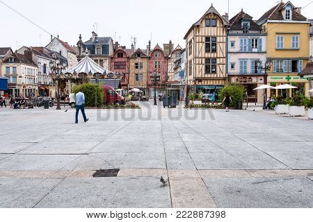 TROYES, FRANCE - JUNE 29, 2010: people, half-timbered houses, carousel on square Place Marechal Foch in Troyes city. Troyes is the capital of the Aube department in Champagne region of Northern France