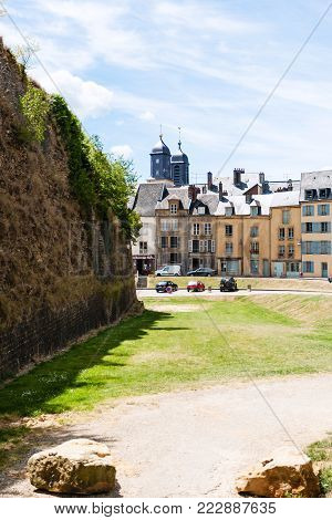 SEDAN, FRANCE - JUNE 30, 2010: castle wall and square Place du Chateau near the castle Chateau de Sedan in summer day. Sedan is a commune in Ardennes department, the castle began to be built in 1424