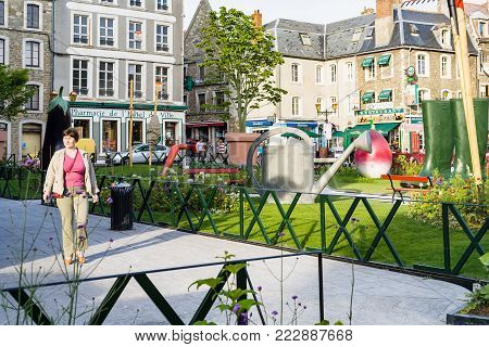 BOULOGNE-SUR-MER, FRANCE - JUNE 30, 2010: tourist near garden Jardin Ephemere on Place Godefroy de Bouillon in summer evening. Boulogne is coastal city in department of Pas-de-Calais of France