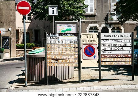 VITRE, FRANCE - JULY 7, 2010: road signs with landmarks names near old town walls on street in Vitre city. Vitre is a commune in the Ille-et-Vilaine department in Brittany in northwestern France