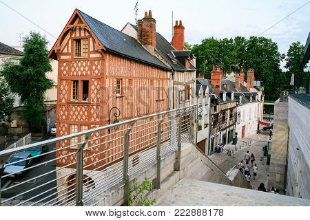ORLEANS, FRANCE - JULY 10, 2010: people near medieval half-timbered house on street Rue de la Poterne in Orleans. Orleans is the capital of the Loiret department and of the Centre-Val de Loire region