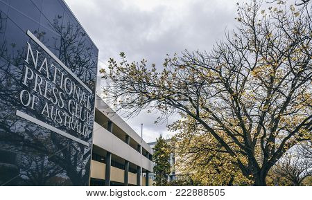 Canberra, Australia - Apr 26, 2017: The National Press Club of Australia building with an oak tree in front. Located along National Circuit. Image taken on an overcast autumn day.