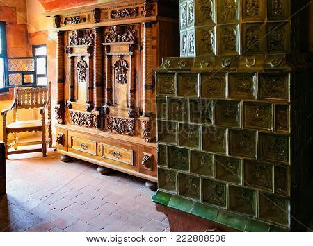 ORSCHWILLER, FRANCE - JULY 11, 2010: inside room in castle Chateau du Haut-Koenigsbourg in Alsace. First time the castle was mentioned in 1147, the building was restored and rebuilt in 1900-1908