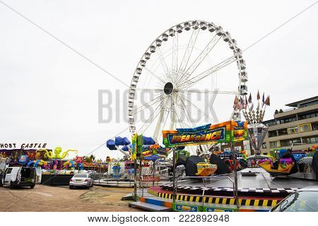 Leiden, The Netherlands 3 October 2017. the empty local fair parks grounds with amusement attractions empty closed with a big round ferris wheel and carousels with bright colors