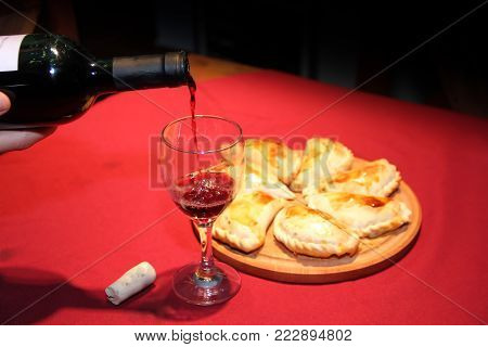 Serving Wine In The Glass With Empanadas Plate Typical South American Food