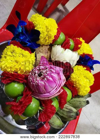 Flowers, marigolds, lotus, banana, coconut  or fruit for the worship in Thailand Temple at Happy new year cerebration