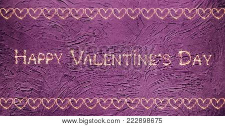 Vintage greeting card Happy Valentines Day. Sparkling golden words Happy Valentine's Day and the pattern of hearts on a lilac grunge background. Holiday Wide screen Web banner