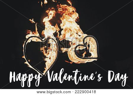 Happy Valentine's Day Text, Greeting Card. Two Golden Fire Hearts Firework On Black Background, Fire