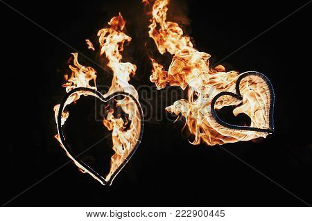 Two Hearts Shaped Firework On Black Background, Fire Show In Night. Happy Valentine's Day Card. Beng