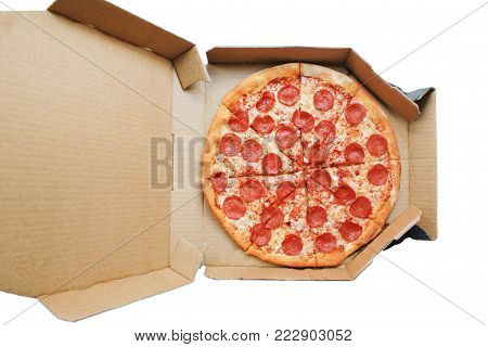 Pepperoni Pizza Isolated on White Background in Delivery Box Top View. Traditional Italian Pizza with Pepperoni Sausage, Mozzarella Cheese and Tomato Sauce. Original Recipe Pizza in Card Paper Box.