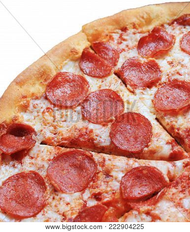 Pepperoni Pizza Close Up Image. Hot Italian Traditional Recipe Pizza Pie with Pepperoni, Cheese and Tomato Sauce Toppings. Freshly Baked Pizza, Fast Food Meal Served at Local Pizzeria Cafe.