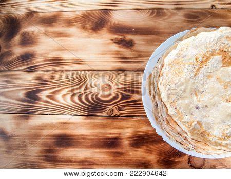Slapjacks on a plate on burnt boards
