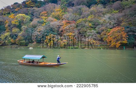 Kyoto, Japan - Nov 28, 2016. Wooden boat on river at Arashiyama in Kyoto, Japan. Arashiyama is a nationally designated Historic Site and Place of Scenic Beauty.