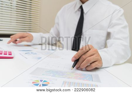 Business And Finance Concept : Businessman Check About Cost And Doing Finance Graph Report At Office