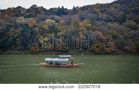 Kyoto, Japan - Nov 28, 2016. Wooden boats on Hozu River at Arashiyama in Kyoto, Japan. Arashiyama is a nationally designated Historic Site and Place of Scenic Beauty.