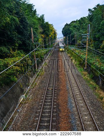 A train running on rail track at countryside in Kyoto, Japan. Rail transport in Japan is a major means of passenger transport.