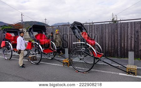 Kyoto, Japan - Nov 28, 2016. Rickshaw service on street in Kyoto, Japan. Kyoto was the capital of Japan for over a millennium, and carries a reputation as its most beautiful city.