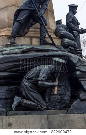 SEVASTOPOL, RUSSIA - MARCH 19, 2011: Close up detail of monument to general Totleben against grey sky showing defenders. Eduard Ivanovich Totleben was a Baltic German military engineer and Imperial Russian Army general