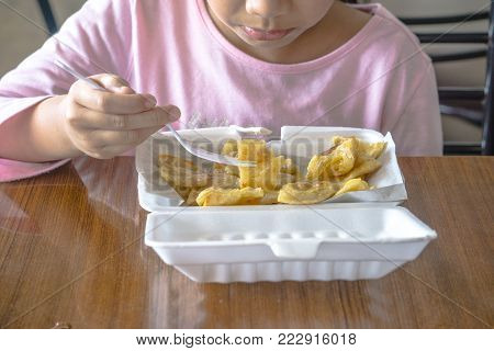 Girl eating yummy Roti with Sweetened condensed milk